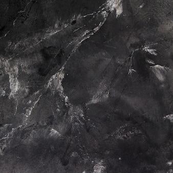 Raue und dunkle schieferoberfläche mit rissen