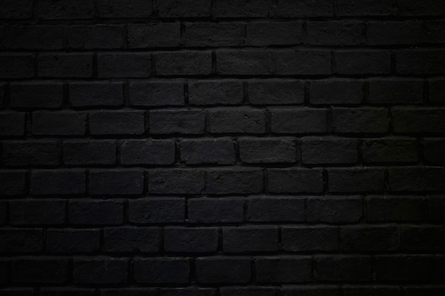 Rauer backsteinmauerbeschaffenheitsziegelsteinhintergrund dunkelschwarz