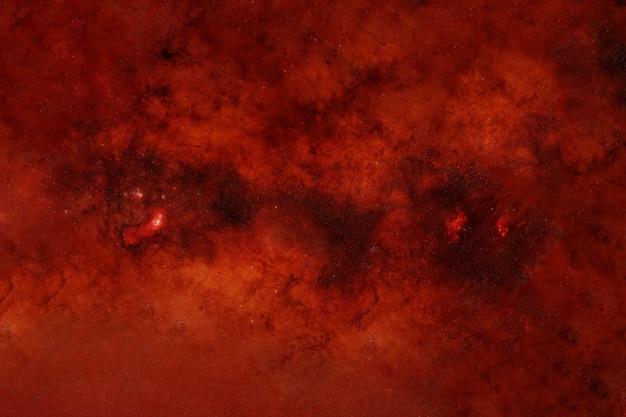 Raum in roten farben. elemente dieses bildes wurden von der nasa bereitgestellt. foto in hoher qualität