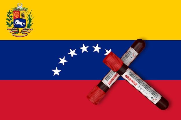 Reagenzgläser mit der aufschrift 2019-ncov auf dem hintergrund der venezuela-flagge. 3d-rendering