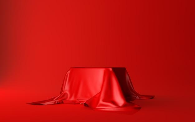 Realistische box bedeckt mit rotem seidentuch isoliert auf rot