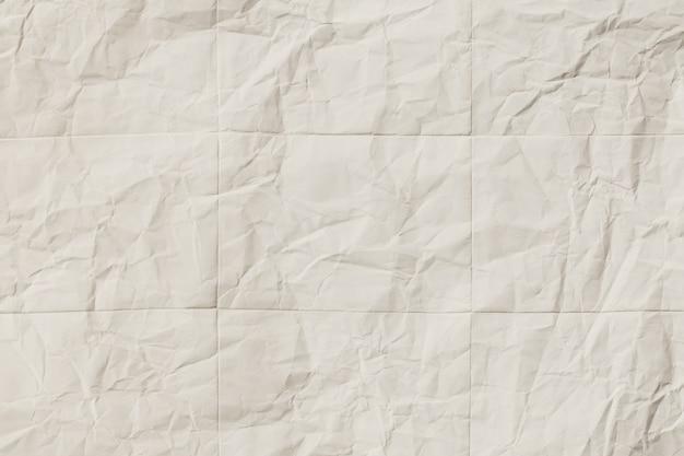 Recyceln sie zerknitterte weiße papierstruktur, abstraktes graues papier, das für hintergrund geknittert wird