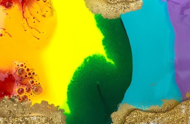 Regenbogen flüssige acryl-mischtinte-textur mit goldstaub