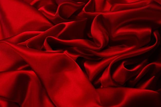 Reicher und luxuriöser roter seidenstoff-texturhintergrund. ansicht von oben.