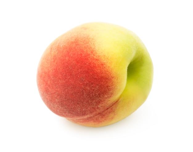 Reife pfirsichfrucht lokalisiert auf weiß