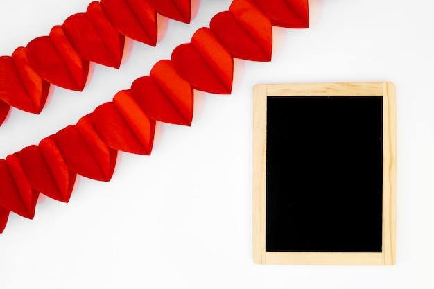 Reihen von roten herzen der verzierung nähern sich fotorahmen
