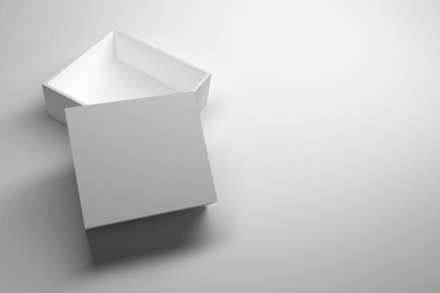 Reiner weißer einzelner geöffneter verpackungskasten, der auf dem tisch steht.