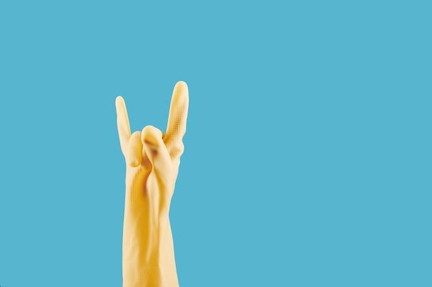 Reinigungshandschuh mit rock'n'roll-geste