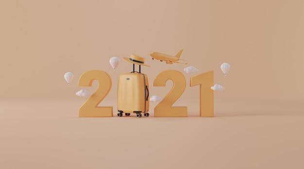 Reiseaccessoires mit koffer als reisejahr 2021 konzept
