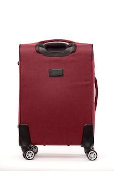 Reisen sie roten koffer lokalisiert auf weißem hintergrund.