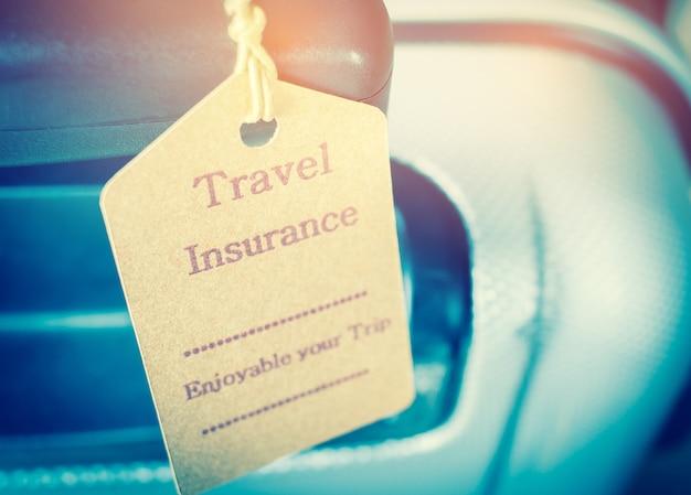 Reiseversicherung tag auf koffer sicherheit mit buchstaben