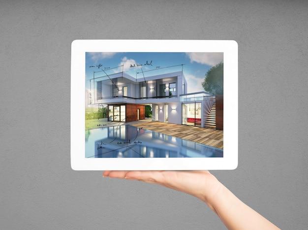 Rendernder architekt, der neues hausprojekt mit tablette zeigt