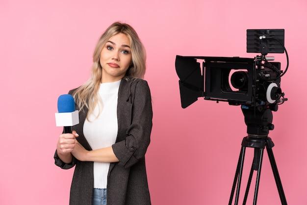 Reporterfrau mit einer kamera