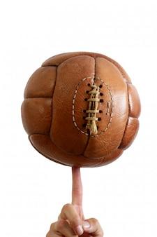 Retro braunes leder der fußballball-weinlese
