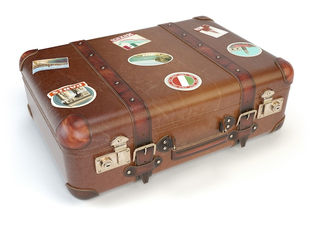 Retro koffergepäck mit reiseaufklebern