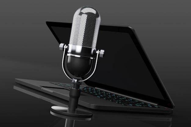 Retro-mikrofon mit laptop auf schwarzem hintergrund