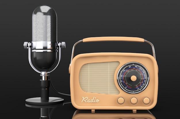 Retro-radio und vintage-mikrofon auf schwarzem hintergrund. 3d-rendering