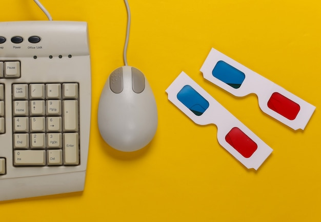 Retro-unterhaltung. altmodische tastatur, pc-maus, anaglyphen-stereobrille auf gelb
