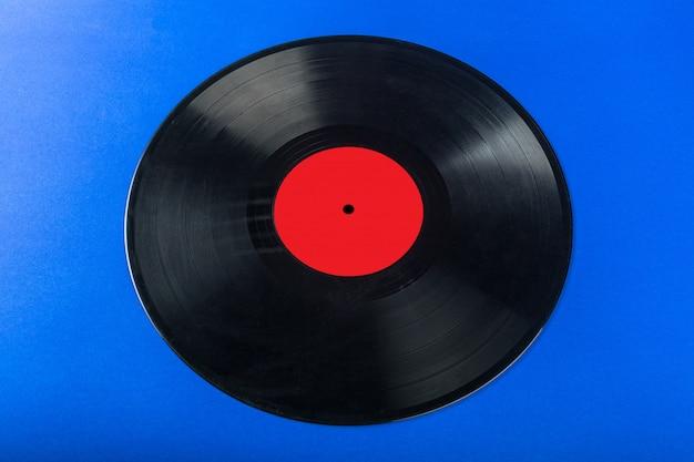 Retro- vinylaufzeichnung auf blauem hintergrund