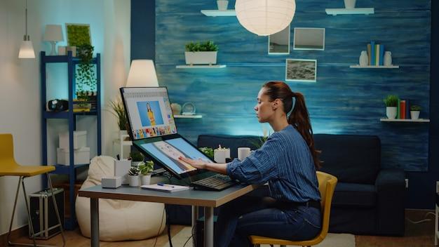 Retuschierkünstler mit bearbeitungssoftware für bilder im studio