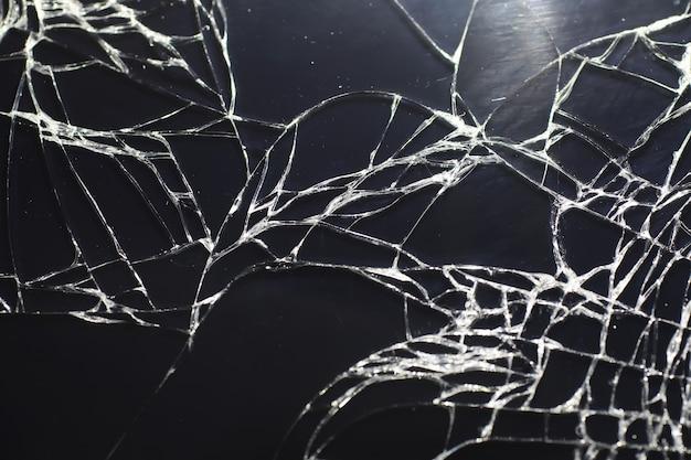 Riss auf dem glas. kaputter bildschirm. telefon kaputt. gebrochener glashintergrund. weiße risse im glas.