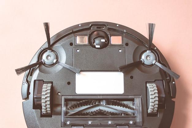 Roboter-staubsauger. moderne intelligente elektronische hauswirtschaftstechnologie.