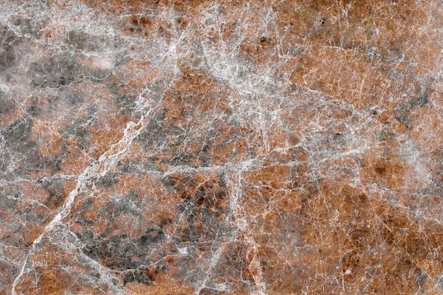 Rötlicher marmorfliesenwandhintergrund