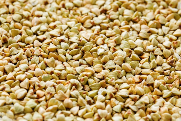 Roher grüner buchweizen, organisches lebensmittel des strengen vegetariers. textur