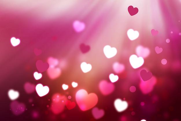 Romantischer hintergrund mit leuchtenden herzen