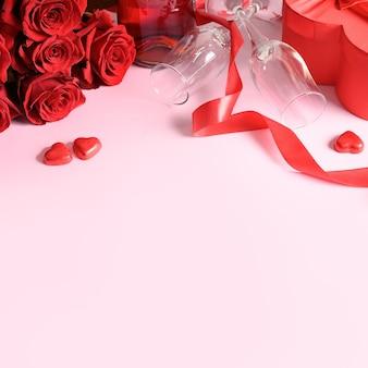 Romantisches set zum valentinstag, rote rosen, geschenk, herzschokoladenbonbons auf rosa. grußkarte mit kopierraum.