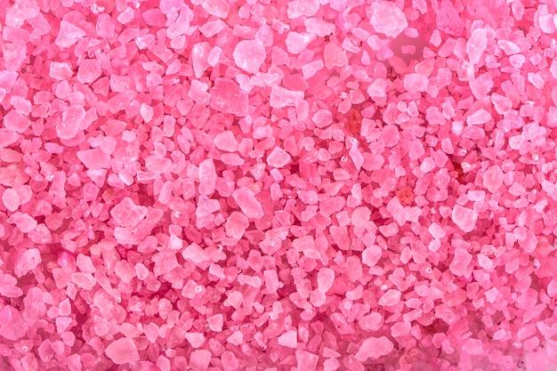 Rosa aromatischer badesalzhintergrund.