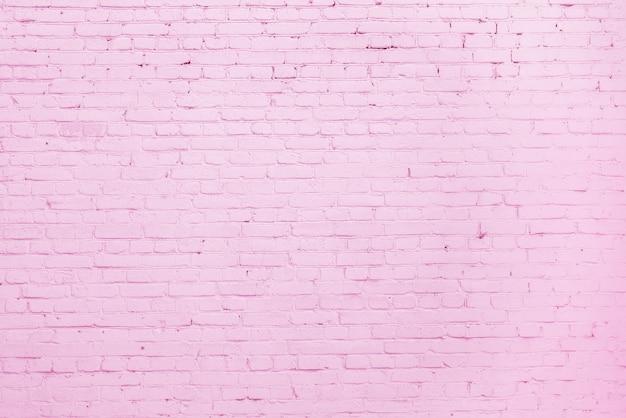 Rosa backsteinmauer. loft innenarchitektur. rosa farbe der fassade. architektonischer hintergrund.