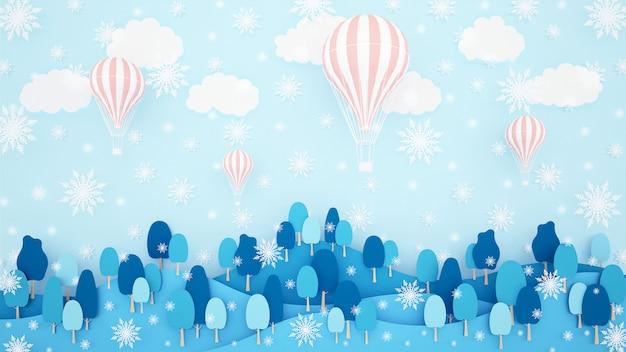 Rosa ballone, wald und schneeflocke auf dem himmelhintergrund.