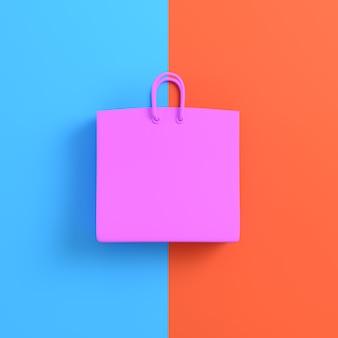 Rosa einkaufstasche auf hellblauem und orange hintergrund