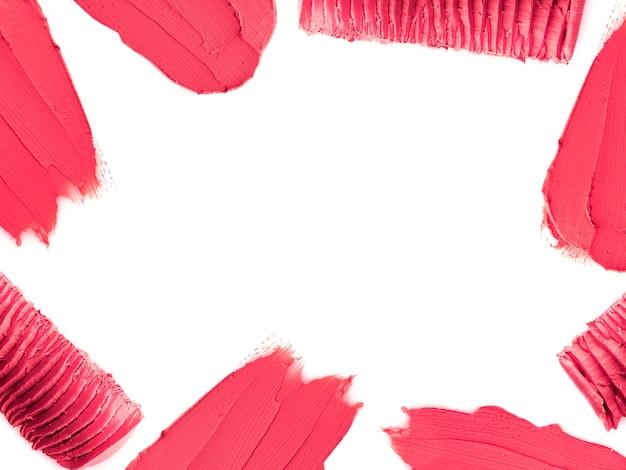 Rosa farbe lippenstiftstrich um rand mit leerem raum