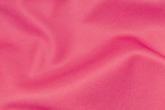 Rosa farbe sportbekleidung stoff fußballtrikot jersey textur und textilhintergrund.