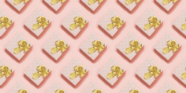 Rosa geschenkboxen mit goldenem band auf pastellrosaoberfläche. ansicht von oben. nahtloses muster.