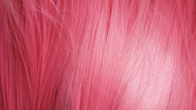 Rosa haarperücke nahaufnahmebeschaffenheit. kann als hintergrund verwendet werden