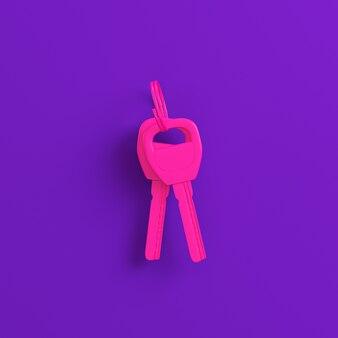 Rosa haus- oder autoschlüssel auf lila