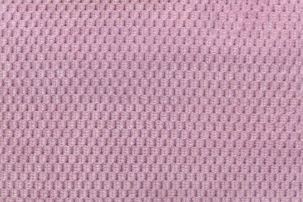 Rosa hintergrund von der weichen flauschigen gewebenahaufnahme. beschaffenheit des textilmakros
