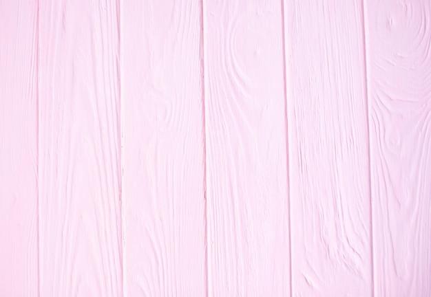Rosa hölzerner hintergrund. rosa holzstruktur mit natürlichen mustern.