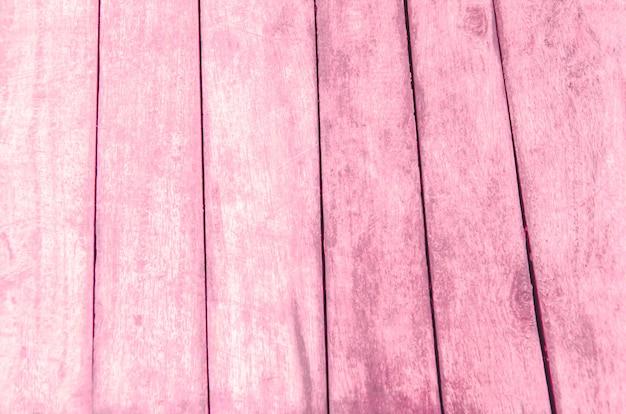 Rosa holzfußboden mit unscharfem musterhintergrund