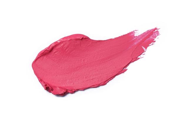 Rosa lippenstift pinselstrich isoliert auf weiß
