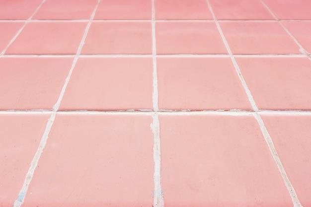 Rosa mit ziegeln gedeckter hintergrund