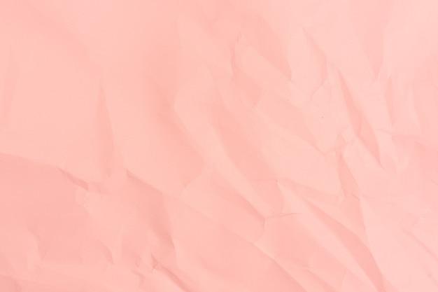 Rosa papierhintergrund. zerknitterte rosa papierbeschaffenheit.