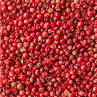 Rosa pfeffer sät hintergrundbeschaffenheit, biologisches lebensmittel
