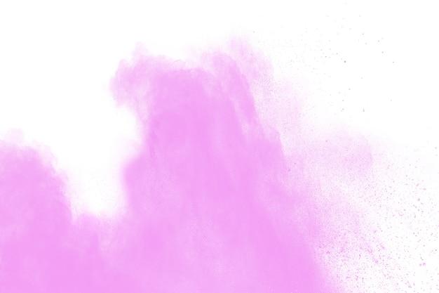 Rosa pulver explosion auf weißem hintergrund. rosafarbene staubspritzenwolke.