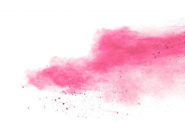 Rosa pulverexplosion auf weißem hintergrund. rosa staubspritzer auf hintergrund.