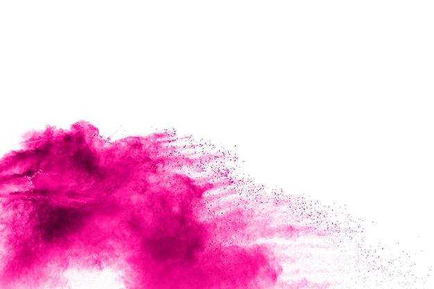 Rosa pulverexplosion auf weißem hintergrund rosa staubteilchenspritzen.