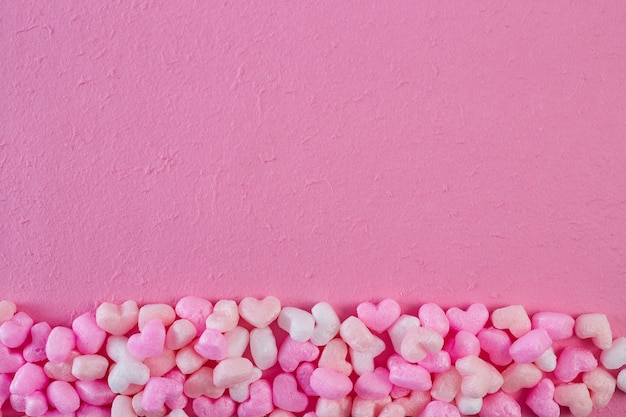 Rosa schaumherzen rosa papierhintergrund